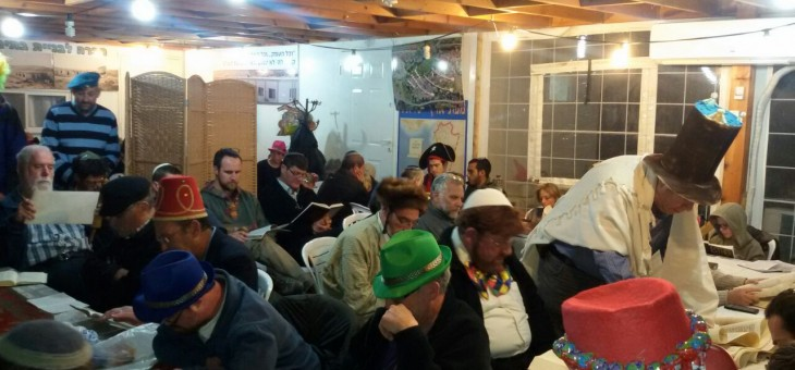 Dozens of people at the Megillah reading in Oz veGaon
